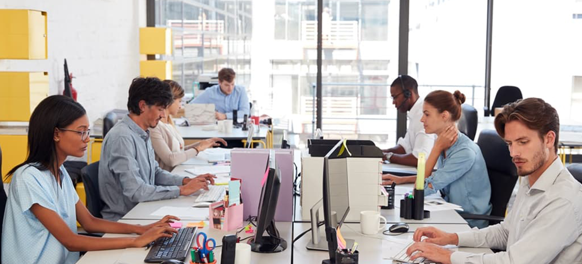 workers in an open plan work space